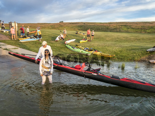 paddlers launching boats for river race