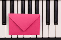 Funny arrangement envelope on the piano keybords