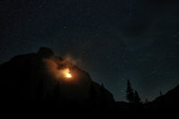 Forest fire in the night at Piegan Pass, Sun Road, Glacier National Park