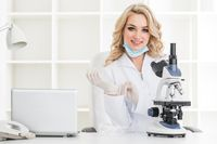 Young scientist looking in laboratory