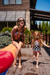 Mom and daughter near the pool, outdoor