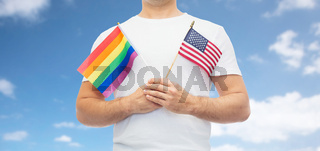 man with gay pride rainbow flag and american