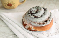 Delicious bun with the glaze and poppy seeds.