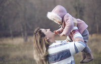 Young mother and baby daughter outside together. Autumn portrait