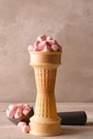 Stacked ice cream cones filled with pink marshmallows