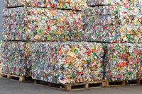 Extruded Aluminum Cans in a Factory for Processing of Secondary Raw Materials.