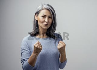 Beautiful Asian woman posing on white background
