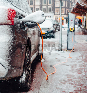 Electric car plug charging in the winter