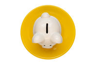 Piggy bank on the yellow plate