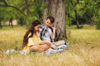 Two kids having picnic together.
