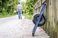 riding onewheel electric skateboard on Katy Trail