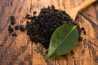 Dry tea and green leaves