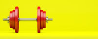red dumbbell isolated on yellow background