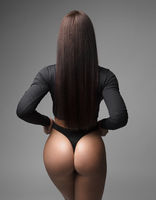 Beautiful athletic ass in thong in a brunette with long straight hair.