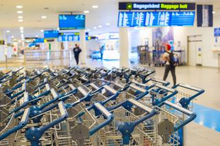 Baggage trolleys at airport terminal