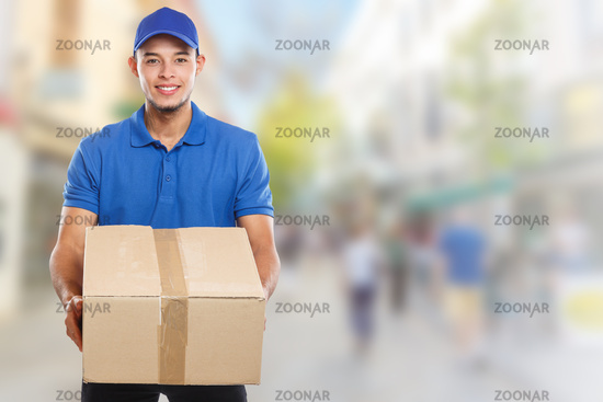 Parcel delivery service box package order delivering job young latin man town copyspace copy space