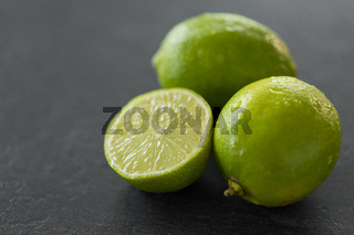 close up of limes on slate table top