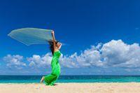 Woman in dress run on beach