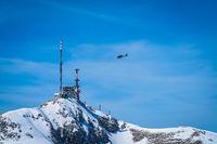 Helicopter flying the Stirovnik peak