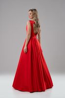Pretty blonde in luxurious red evening dress shot