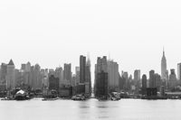 New York City midtown Manhattan skyline panorama view from Boulevard East Old Glory Park over Hudson River.