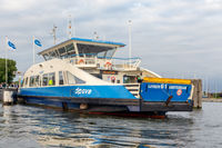 Passengers on board of a ferry across Amsterdam IJ river