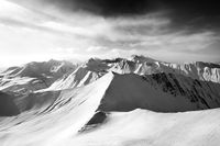 Black and white off-piste slope and sunlight sky