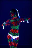 Woman with beautiful UV bodyart cropped shot