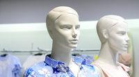 Closeup plastic mannequin heads against blurred shop background
