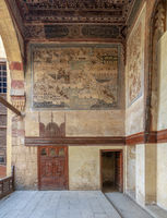 Stone wall decorated with mural depicting Istanbul city at ottoman historic Waseela Hanem House, Old Cairo, Egypt