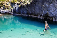 Woman enjoying the cool blue waters of the limestone caves