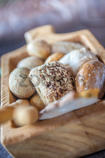 Delicious basket with bread rolls on a alpine hut in South Tyrol, Italy