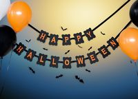 happy halloween party garland and balloons