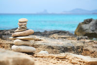Art of stone balance, piles of stones on the Illetes beach. Selective focus. Formentera. Balearic Islands. Spain