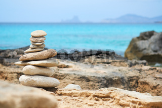 Art of stone balance, piles of stones on the Illetes beach. Selective focus. Formentera. Balearic Islands. Spain