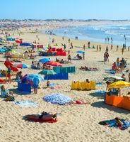 People rest ocean beach. Portugal