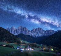 Santa Maddalena and Milky Way at night in autumn in Italy