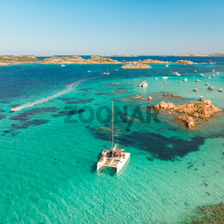 Drone aerial view of catamaran sailing boat in Maddalena Archipelago, Sardinia, Italy.