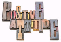 positive attitude word abstract in wood type