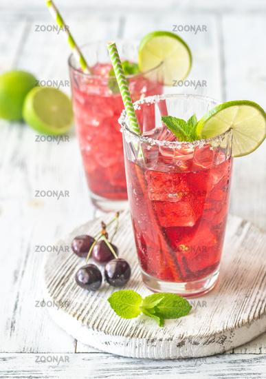 Two glasses of cherry mojito