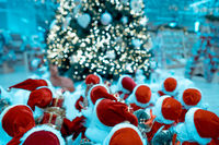 Several small toy Santa Clauses stand in a group