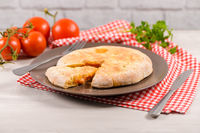 Pizza calzone on wooden background
