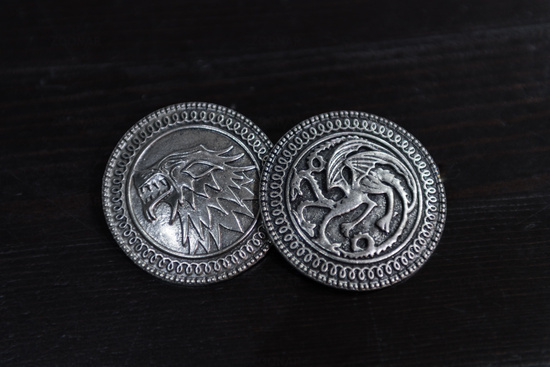 Metal medals inspired by the Stark house shields and Targaryen from the TV series Game of Thrones for sale as amulets.