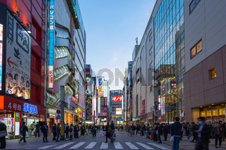 Crowd of tourist are travelling in Akihabara shopping district , Tokyo city, Japan