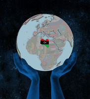 Libya on political globe in hands