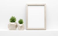 wooden picture frame mock up and green potted plants on white shelf