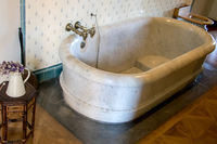 Historic bathroom from 19th century with marble bathtub