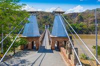 western bridge suspended in Santa Fe of Antioquia on the river Cauca Colombia