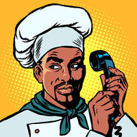 Food delivery. African Chef takes orders by phone