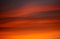 burning clouds in the evening sky after sunset